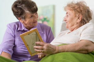volunteer reading to nursing home resident