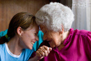 female volunteer with older woman