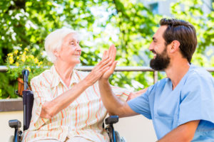 young man and older woman high fiving