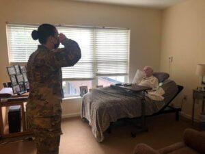 Active-duty volunteer saluting a veteran